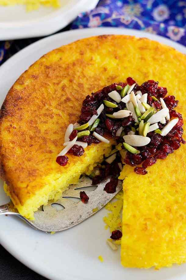Persian Savory Saffron Cake - Tahchin is a very delicious traditional Persian rice dish full of saffron and great flavors. It is usually served with chicken in tomato sauce.