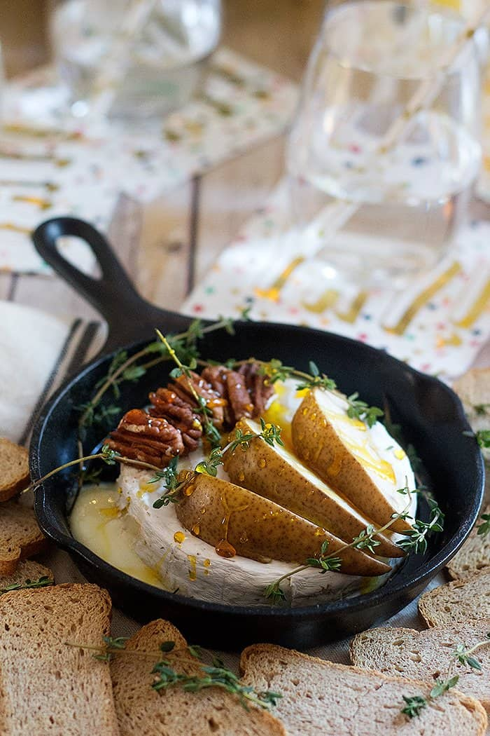 Honey Pecan Baked Brie is a quick and delicious appetizer you can put together in no time for a small gathering. Always add some thyme for a tasty kick!