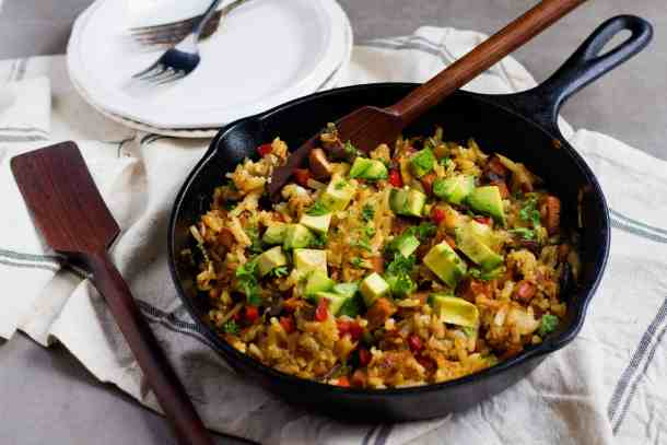 Skillet Hash Browns topped with avocados for breakfast or brunch.