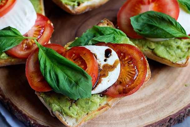 Caprese Sandwich Recipe - Italian bread with avocados, tomatoes and mozzarella. Topped with balsamic reduction and basil.