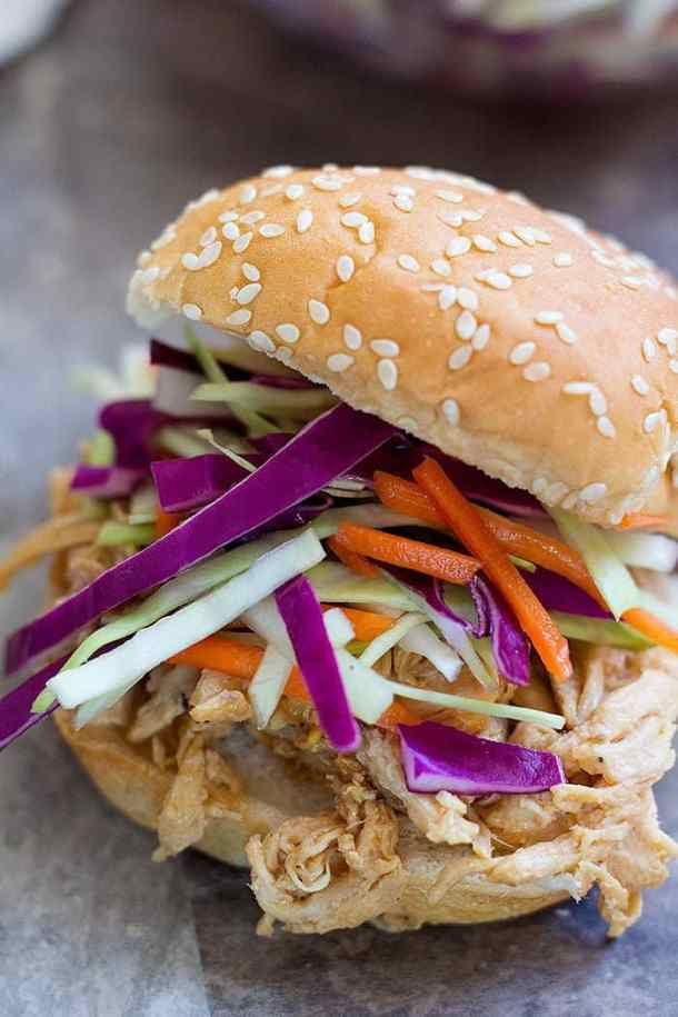 These Asian Chicken Sliders are to die for! Shredded chicken mixed with Asian flavors and a delicious slaw, these chicken sliders are perfect for feeding a crowd!