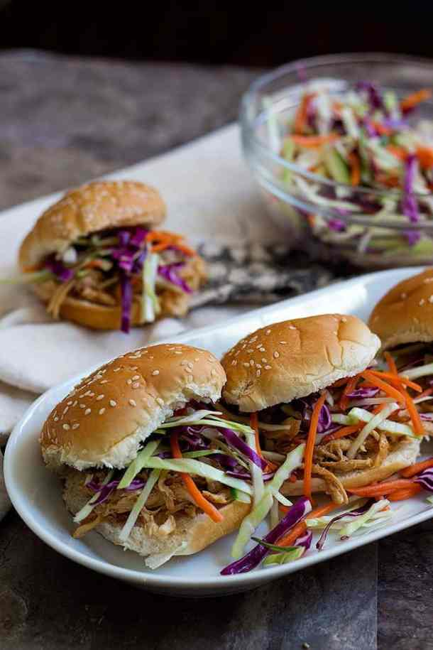 Asian Chicken Sliders - Put some shredded chicken and slaw on each slider and serve immediately.