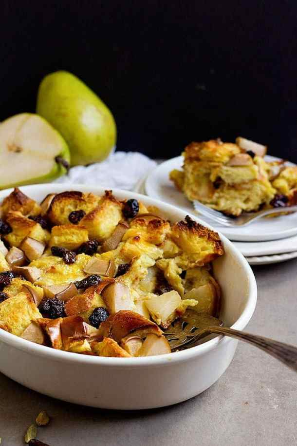 Challah bread pudding - cut into the bread pudding and plate. Serve the bread pudding warm with maple syrup.