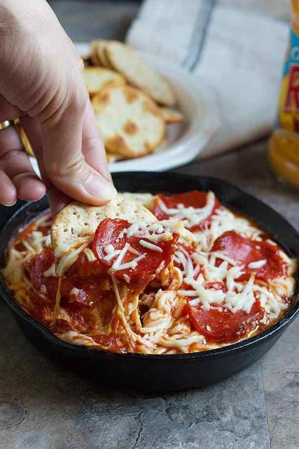 This Pizza Dip is the perfect game day food. Creamy dip topped with pepperoni has tons of flavor in every bite and is a great choice for parties and gatherings!