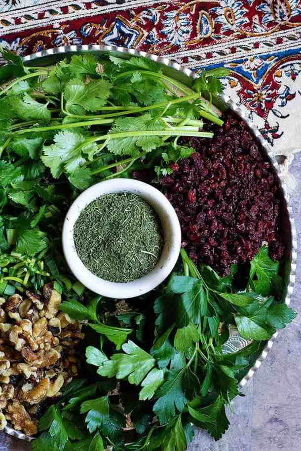 Ingredients for Kuku Sabzi are Parsley, leeks, cilantro, dill, walnuts and barberries.