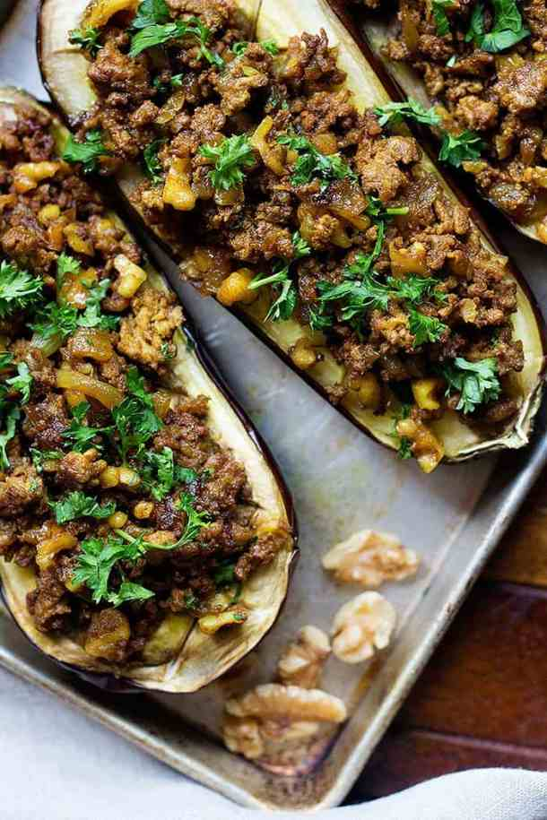 Stuffed Eggplant with Walnuts and Lamb is a family favorite. Juicy eggplants are roasted to perfection, topped with spicy lamb and crunchy walnuts. It's the perfect combination of flavors!