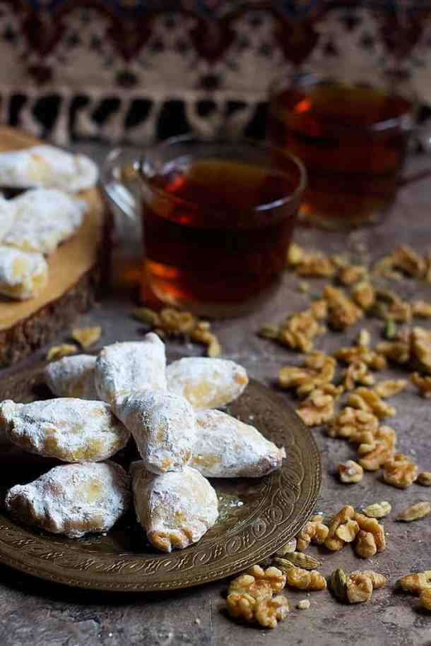 Qottab is a Persian pastry filled with walnuts is a delicious traditional treat from Iran. Delicate and flaky dough is filled with a combination of walnuts and cardamom - making this the perfect Persian dessert!