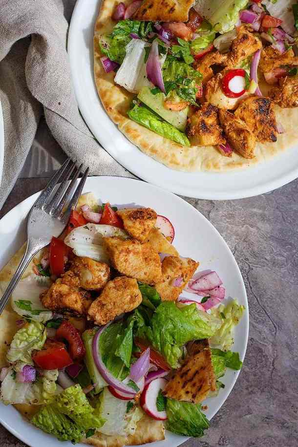 Shish Taouk is Tender chicken marinated in yogurt, lemon and garlic which makes one delicious Middle Eastern meal for the family.
