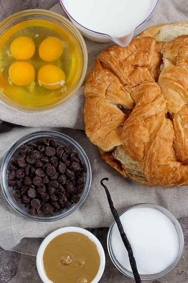 To make croissant bread pudding you need milk, sugar, croissants, eggs and chocolate chips