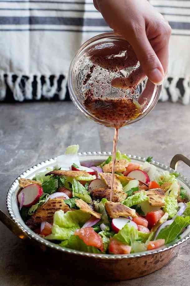 Pour fattoush dressing over the salad and mix well.