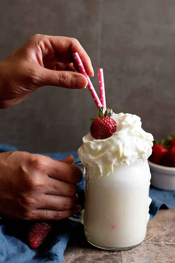 This vanilla shake is perfect for hot summer days. Top it with s strawberry for maximum flavor.