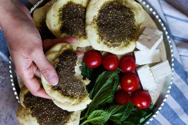 manakeesh or manakish zaatar bread goes perfectly with feta tomatoes and basil