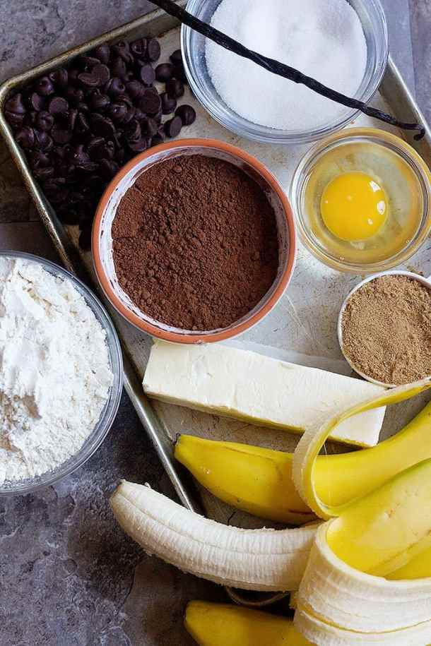 cocoa banana bread ingredients are bananas, sugar, egg, chocolate chips, cocoa powder, flour and butter.