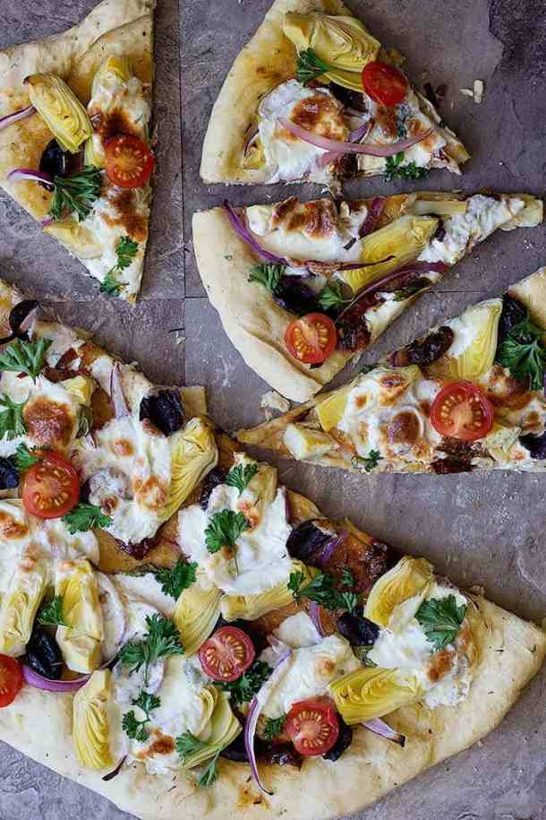 Mediterranean pizza is the ultimate easy fresh family dinner that everyone will devour. This is a delicious homemade pizza recipe with different Mediterranean toppings that would knock your socks off!