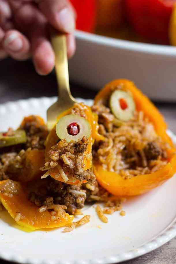 This stuffed peppers recipe is made with rice, beef and spices.