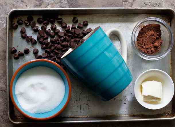 To make chocolate fudge brownies in a mug you need butter, sugar, cocoa powder, water and chocolate chips.