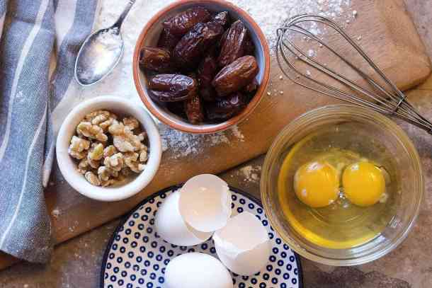 To make date and walnut cake you need eggs, dates, walnuts, flour, sugar and baking powder.
