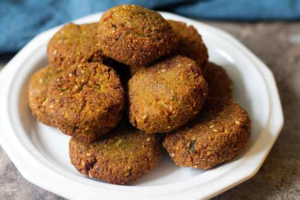 Fry homemade falafel in oil util golden brown on all sides.
