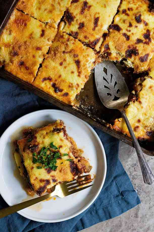 Greek moussaka is a classic Greek comfort food made with layers of eggplant, ground meat and bechamel sauce.