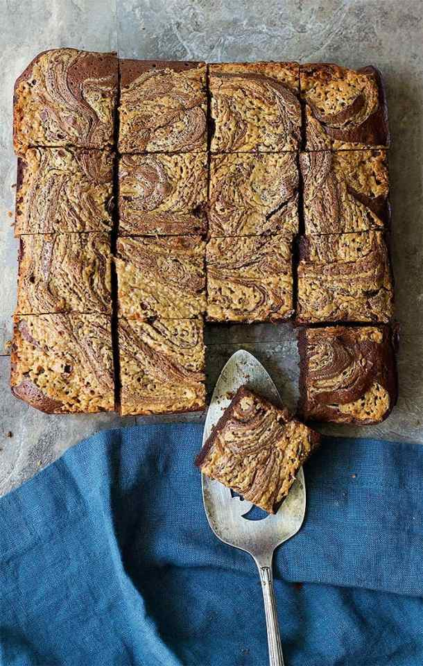 Fudgy chocolate brownies topped with a luscious peanut butter swirl are absolutely delicious. Learn how to make peanut butter brownies from scratch and wow everyone!