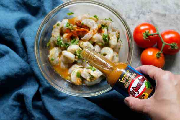For spicy shrimp tacos marinade, add hot sauce to the shrimps.