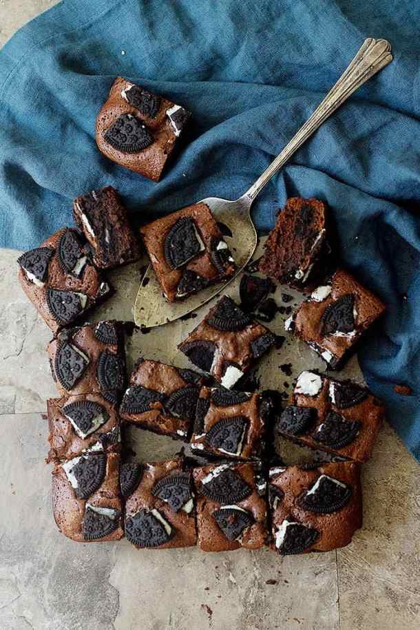 Oreo stuffed brownies cut into sixteen pieces. These brownies are absolutely tasty.