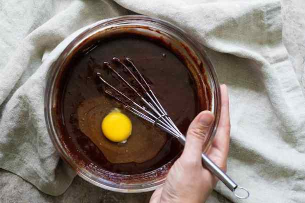 Add the eggs one by one to the oreo brownie batter.
