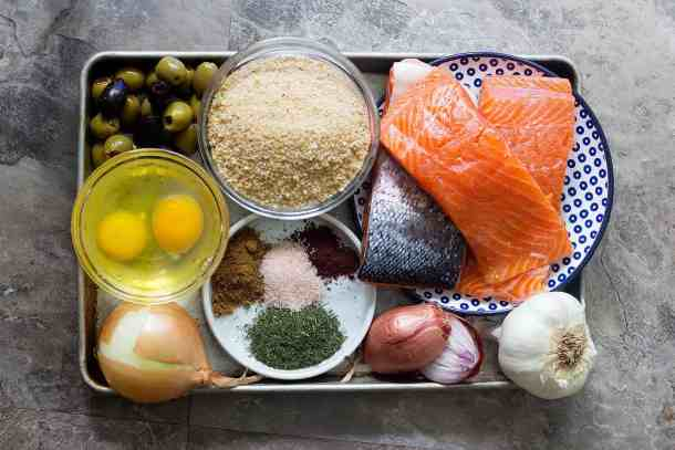 Salmon patties ingredients are salmon, eggs, onion, shallots, garlic, bread crumbs, spices and olives.