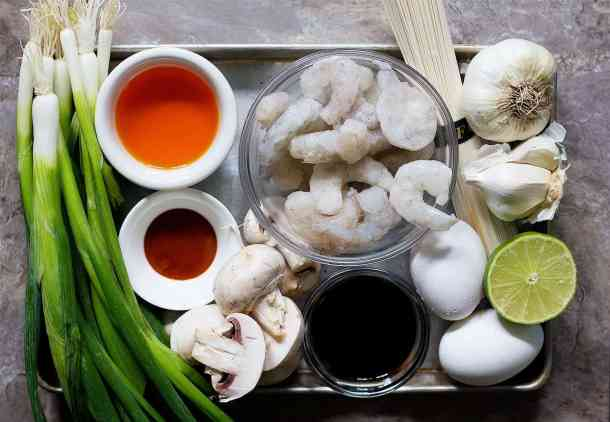 Spicy Ramen ingredients are chicken stock, shrimp, garlic, noodle, lime, soft boiled eggs, sesame oil, mushrooms and sriracha.