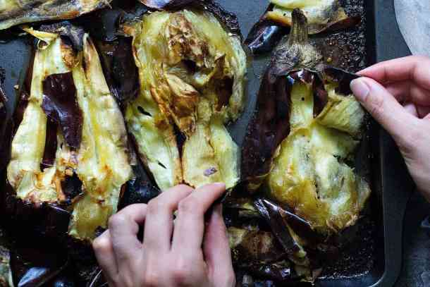 Roast and peel the eggplants to make baba ganoush.
