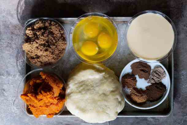 Pumpkin pie ingredients are pumpkin puree pie crust, eggs, brown sugar, spices and evaporated milk.