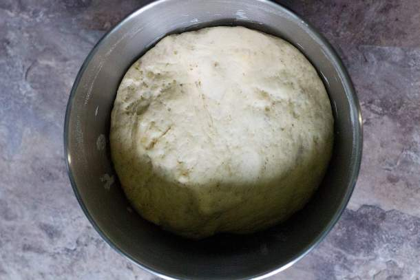 Make the pita bread dough and let it rise for one hour until it doubles in size.