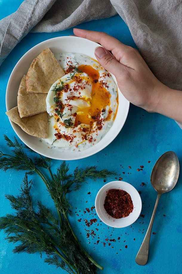 Cilbir is served with a spicy yogurt sauce that's flavored with dill and garlic.