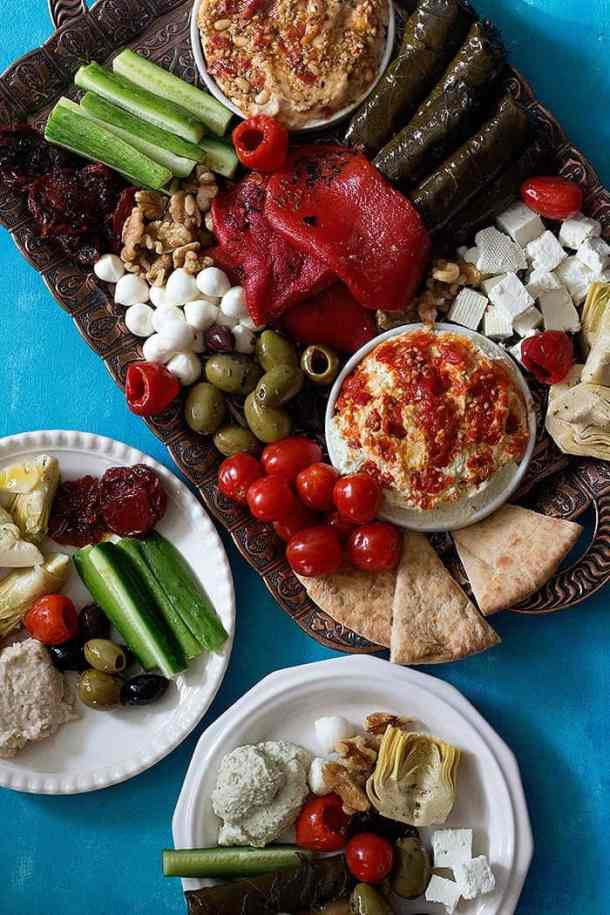 Mezze platter takes your appetizer game to a whole new level. This Mediterranean platter is a showstopper at any gathering and it's so simple to make.