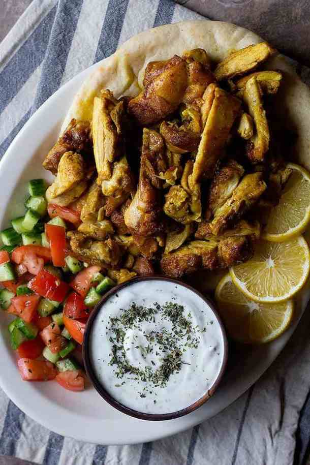 This chicken shawarma recipe is going to change your life! Learn how to make homemade chicken shawarma and serve it with pita, Mediterranean salad and a delicious sauce!