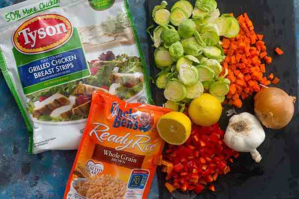 To make this easy skillet dinner, you need olive oil, onion, red bell pepper, carrots, garlic, brussels sprouts and spices, plusTyson® Fully Cooked Refrigerated Grilled Chicken Breast Strips and Uncle Ben's® Ready Rice® Whole Grain Brown.