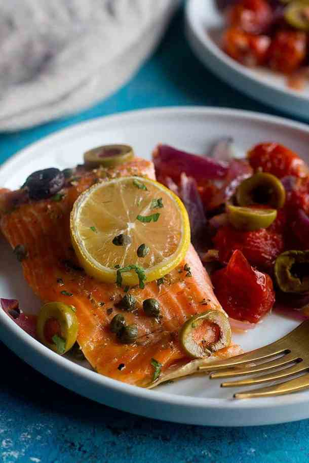 oven baked salmon with lemon, capers and olives.