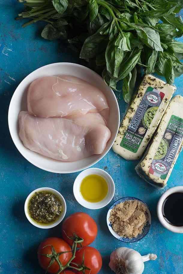 To make this tasty stuffed chicken breast you need chicken cheese basil pesto tomato balsamic