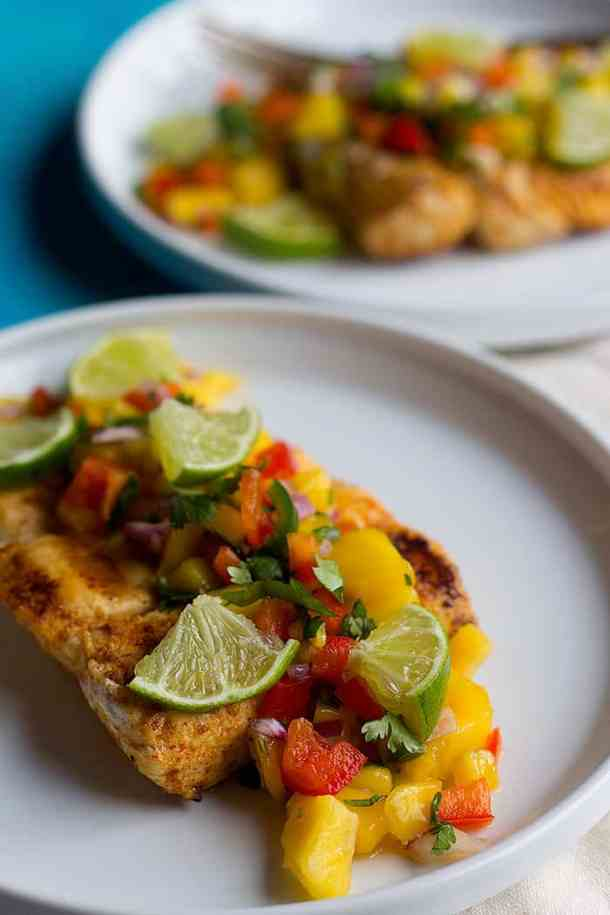 Top halibut with homemade mango salsa to have so much flavor