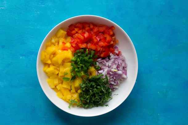 To make mango salsa, mix mango, red pepper, red onion and cilantro and jalapeno in a bowl