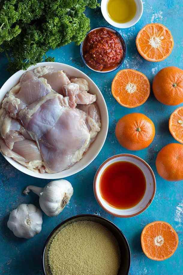 To make harissa chicken you need chicken thighs, harissa, olive oil, clementines, garlic and saffron