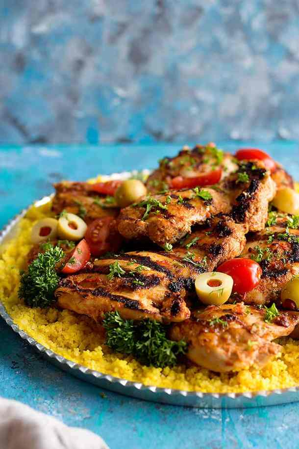Grilled harissa chicken made with harissa paste and served with couscous