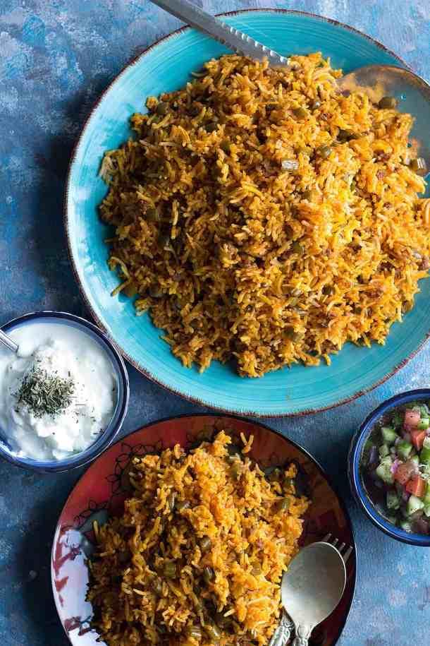 Serve lubia polo with salad shirazi and yogurt.