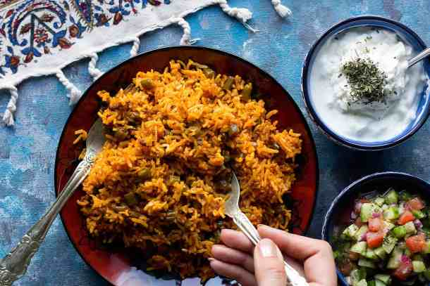 loobia polo is made with green beans and rice and beef.