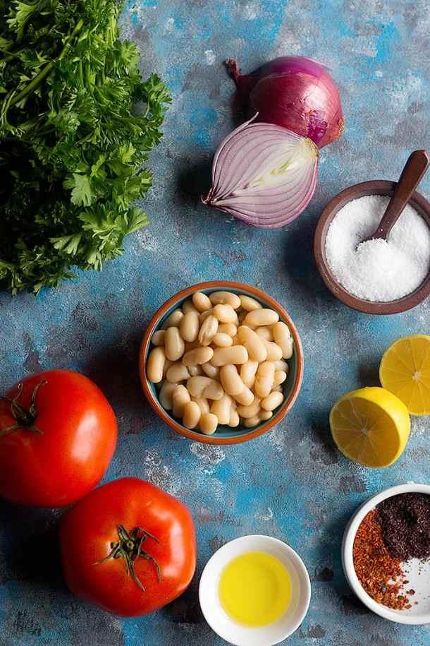 To make turkish white bean salad you need white beans, parsley, lemon, tomato and onions