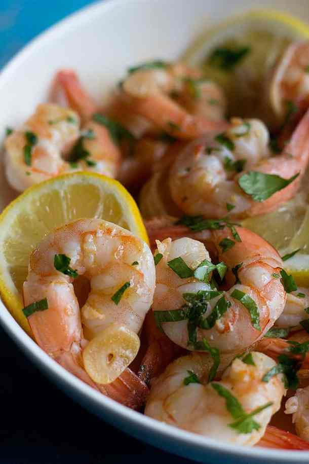 squeeze some lemon on cooked prawns and serve immediately.
