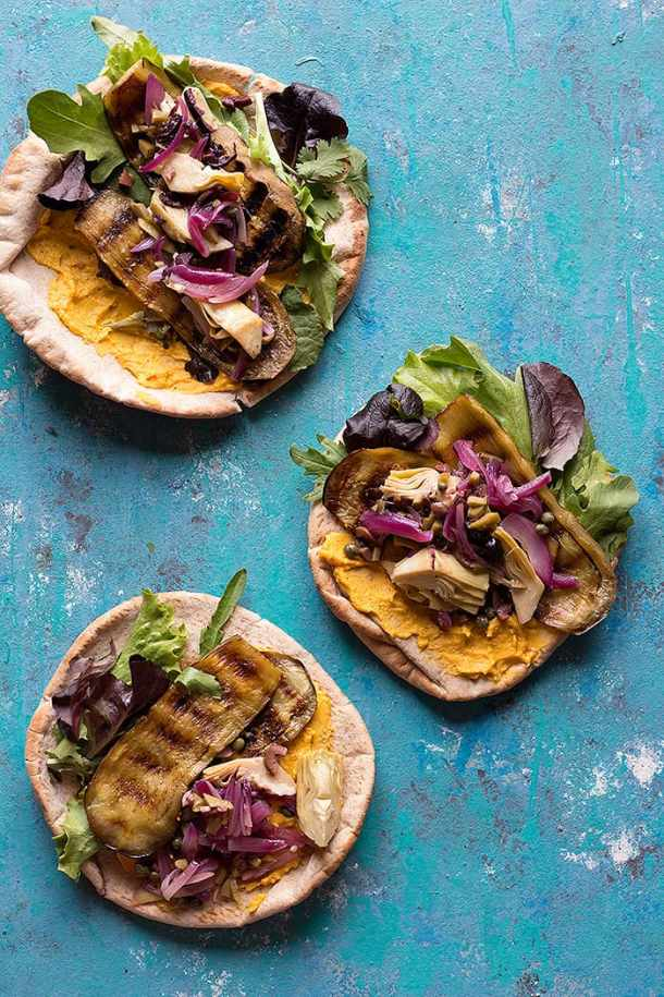 Three pita breads filled with grilled eggplant, greens, onion and hummus.