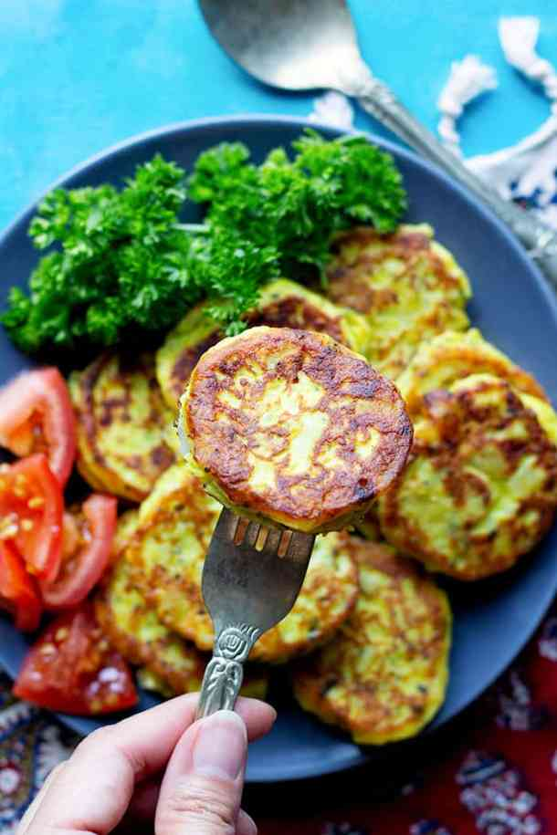 a piece of homemade potato pancake with vegetables.