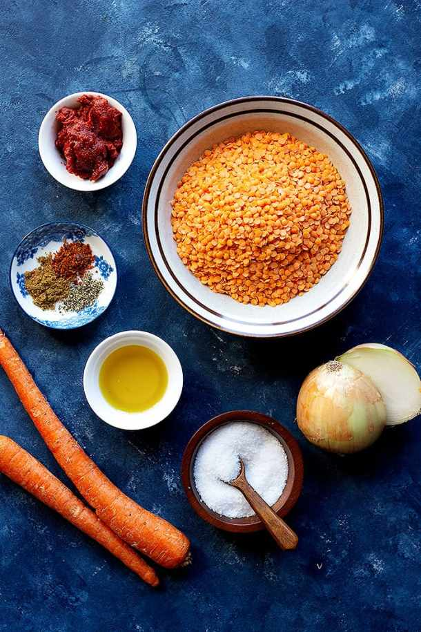 To make mercimek corbasi you need red lentils, tomato paste, spices, olive oil, onion and carrots.