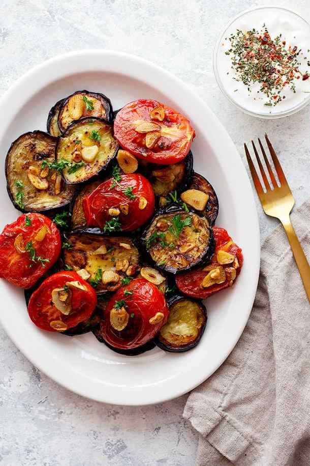 Fried eggplant with tomatoes are the easiest side dish. Fresh eggplant and tomatoes fried to perfection and are topped with crispy garlic.